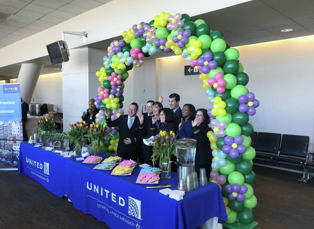 Balloons, flowers and other goodies along with some very happy flight attendants at United's inaugural SFO-Amsterdam flight celebration