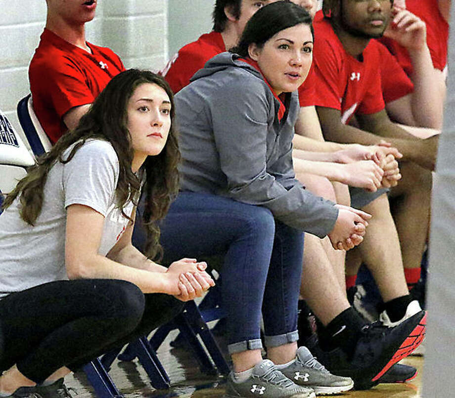 Alton boys volleyball coach Jenna Wiedman, right, and junior varsity coach Kenlea Herndon watch the action at Thursday's JV match at Marquette. Photo: Greg Shashack | The Telegraph