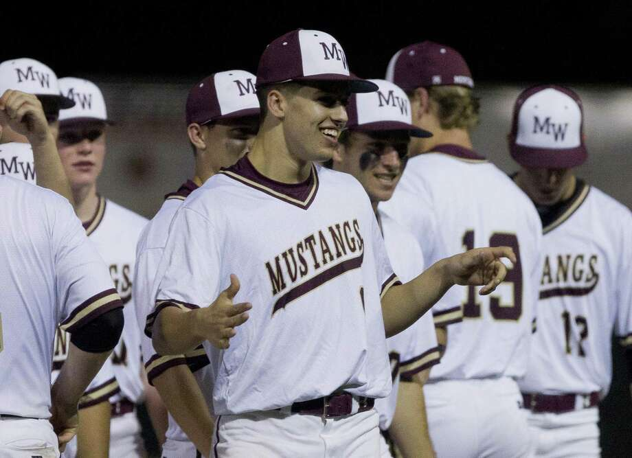 In this file photo, Magnolia West starting pitcher Connor Phillips (9) smiles after a win earlier this season. Photo: Jason Fochtman, Houston Chronicle / Staff Photographer / © 2019 Houston Chronicle