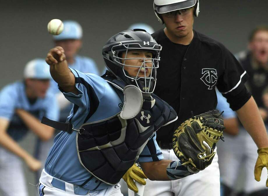 Johnson catcher Dominic Tamez fires to first on a pickoff attempt against Clark during Game 1 of their best-of-3 first round playoff series at North East Sports Park on Thursday, May 2, 2019. Photo: Billy Calzada, Staff / Staff Photographer / San Antonio Express-News