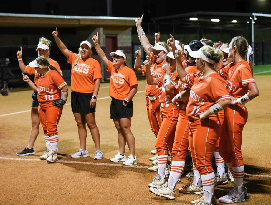 Orangefield's players and coaches celebrate after the game against New Waverly at Jasper Thursday night. Photo taken on Thursday, 05/02/19. Ryan Welch/The Enterprise Photo: Ryan Welch, The Enterprise / © 2019 Beaumont Enterprise
