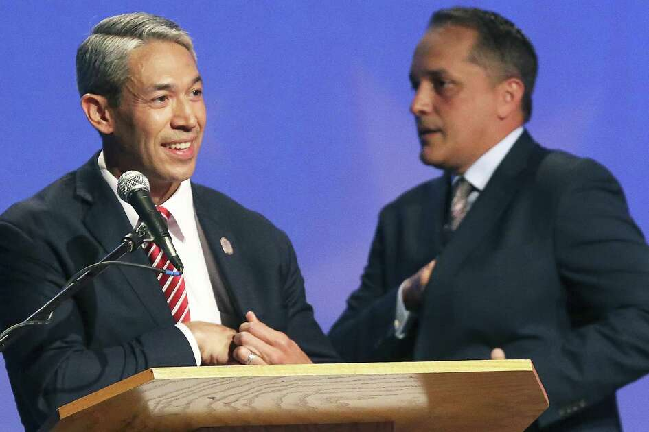 The Two Candidates Pass Each Other Still Avoiding Eye Contact After Session As Ron Nirenberg