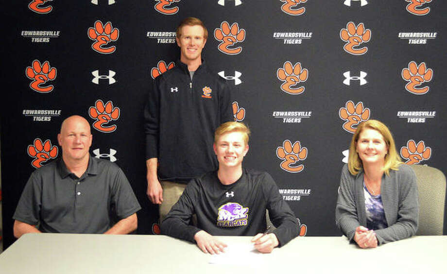 Edwardsville senior Mason Young, seated middle, signed to play hockey at McKendree University. He is joined by his parents and EHS coach Jason Walker. Photo: Scott Marion/The Intelligencer