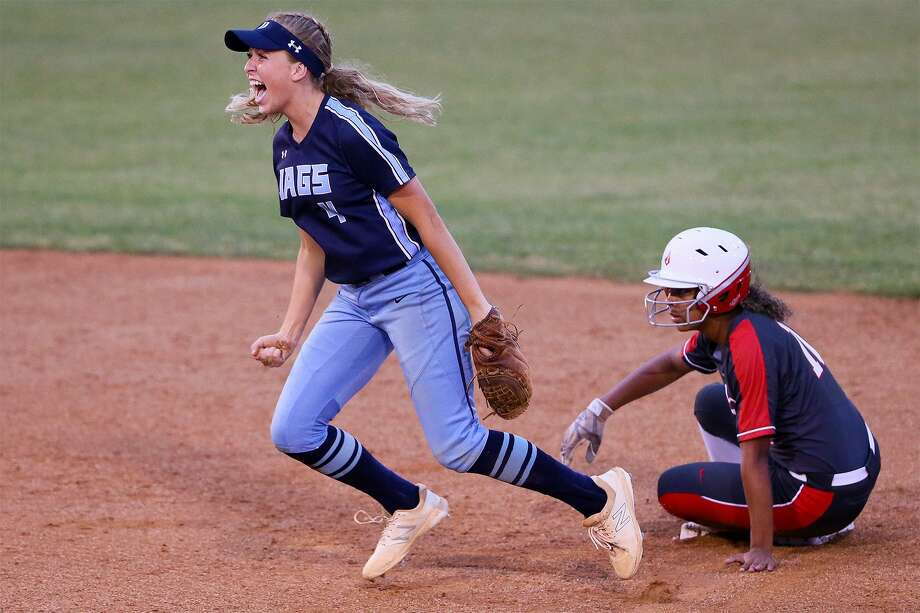 Johnson's Ally Oyanguren, left, celebrates after forcing out Judson's Keely Williams at second base during the third inning of their UIL Class 6A second-round high school softball playoff game at Northside ISD softball field No. 2 on Thursday, May 2, 2019. Judson advanced to the next round with a 4-2 victory over Johnson in the one-game series. Photo: Marvin Pfeiffer, Staff Photographer / Express-News 2019