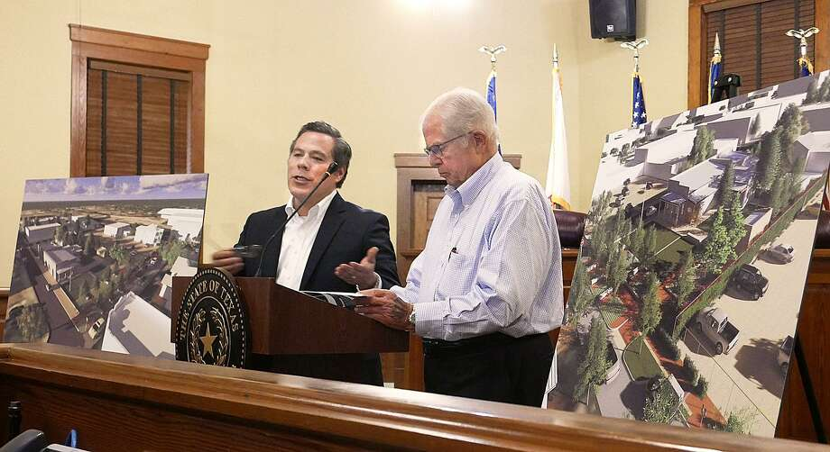 Eddie Quiroga, of Metaform Studios, and Kennedy Whiteley, of Ausland Architects, delivered an update on the veteran's museum Thursday at the Webb County Commissioners Court. Photo: Cuate Santos /Laredo Morning Times / Laredo Morning Times