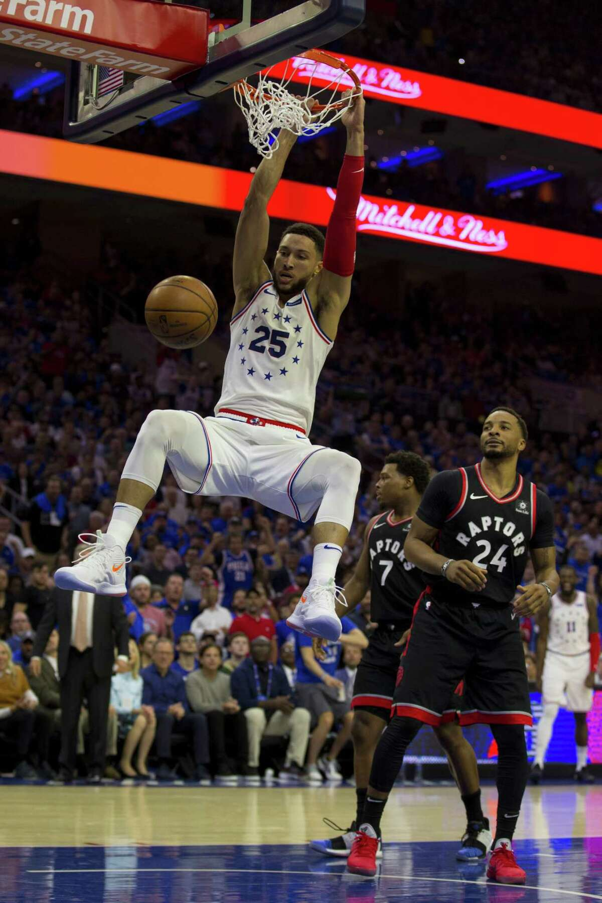 PHILADELPHIA, PA - MAY 02: Ben Simmons #25 of the Philadelphia 76ers dunks the ball past Norman Powell #24 of the Toronto Raptors in the second quarter of Game Three of the Eastern Conference Semifinals at the Wells Fargo Center on May 2, 2019 in Philadelphia, Pennsylvania. NOTE TO USER: User expressly acknowledges and agrees that, by downloading and or using this photograph, User is consenting to the terms and conditions of the Getty Images License Agreement. (Photo by Mitchell Leff/Getty Images)