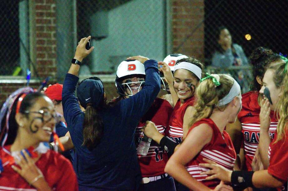 Dawson's Courtney Day (17) receives a congratulatory pat on the helmet after her eighth-inning walk-off home run in a 6-5 Lady Eagle win over Summer Creek Thursday night. Photo: Kirk Sides / Staff Photographer / © 2019 Kirk Sides / Houston Chronicle
