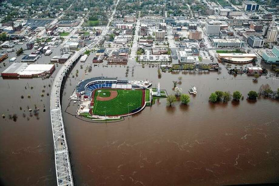 Downtown Davenport, Iowa, is seen from the air as flood waters continue flow Wednesday. A flood wall broke Tuesday, sending water to near record levels with little to no warning. Photo: Brian Powers | The Des Moines Register Via AP