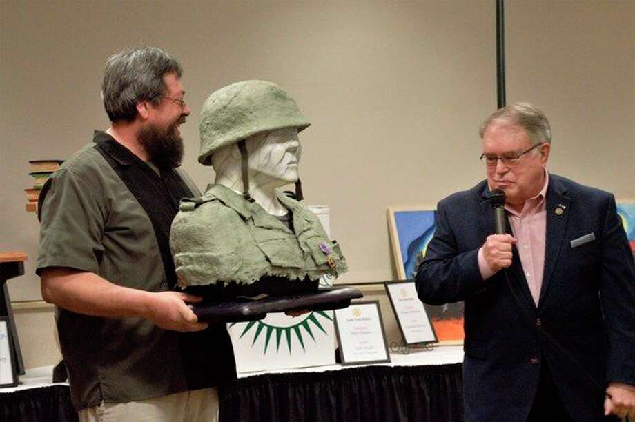 John Martinez (left) and Fred Honerkamp (right) explain that the paper mache bust was inspired by Honerkamp's service in the Vietnam War 50 years ago. (Ashley Schafer/ashley.schafer@hearstnp.com)