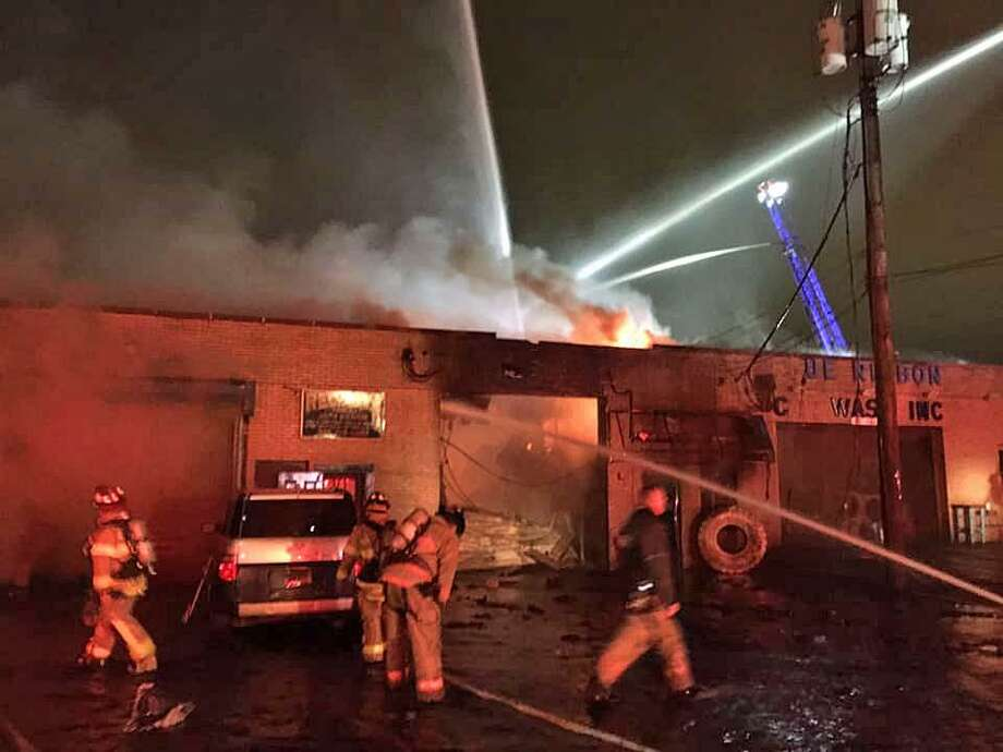 Investigators are trying to determine the cause of a three-alarm fire that destroyed a commercial building on Elm Street early Friday, May 3, 2019. Crews responded to a report of a fire at 21 Elm St. at around 12:40 a.m. to find the building engulfed in flames, the Local 1198 firefighters said on its Facebook page. Photo: West Haven Professional Firefighters Photo