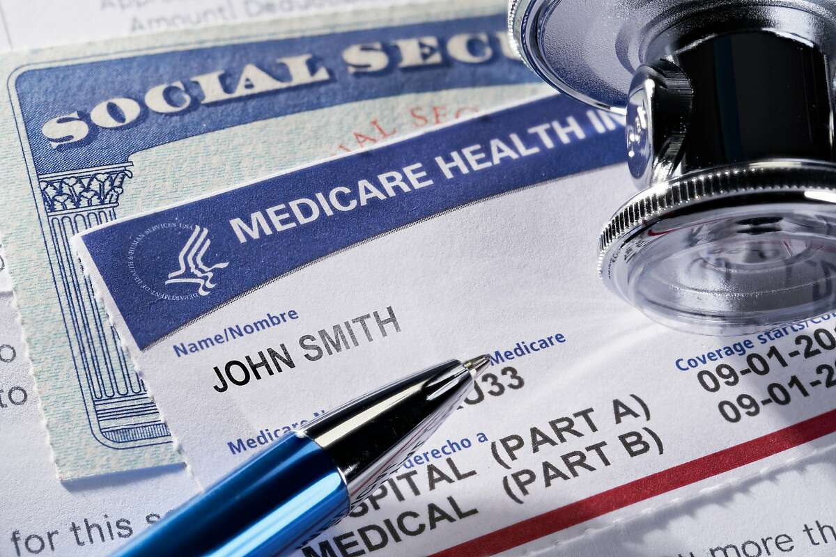 THE SEA RANCH, CALIFORNIA - November 12, 2018: Medicare Health Insurance and Social Security card on medical report with stethoscope. Medicare is a national health insurance program provided by the United States for seniors 65 and older. Social Security is a federal insurance program that gives benefits to retired, unemployed and disabled people.