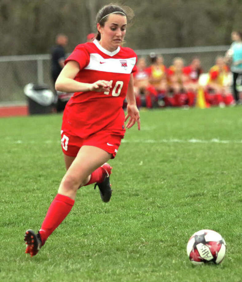 Alton's Calista Cox, shown in action at home earlier this season, scored a goal in the second overtime to give the Redbirds a 1-0 SWC victory over the Kahoks on Thursday night in Collinsville. Photo: Greg Shashack / The Telegraph