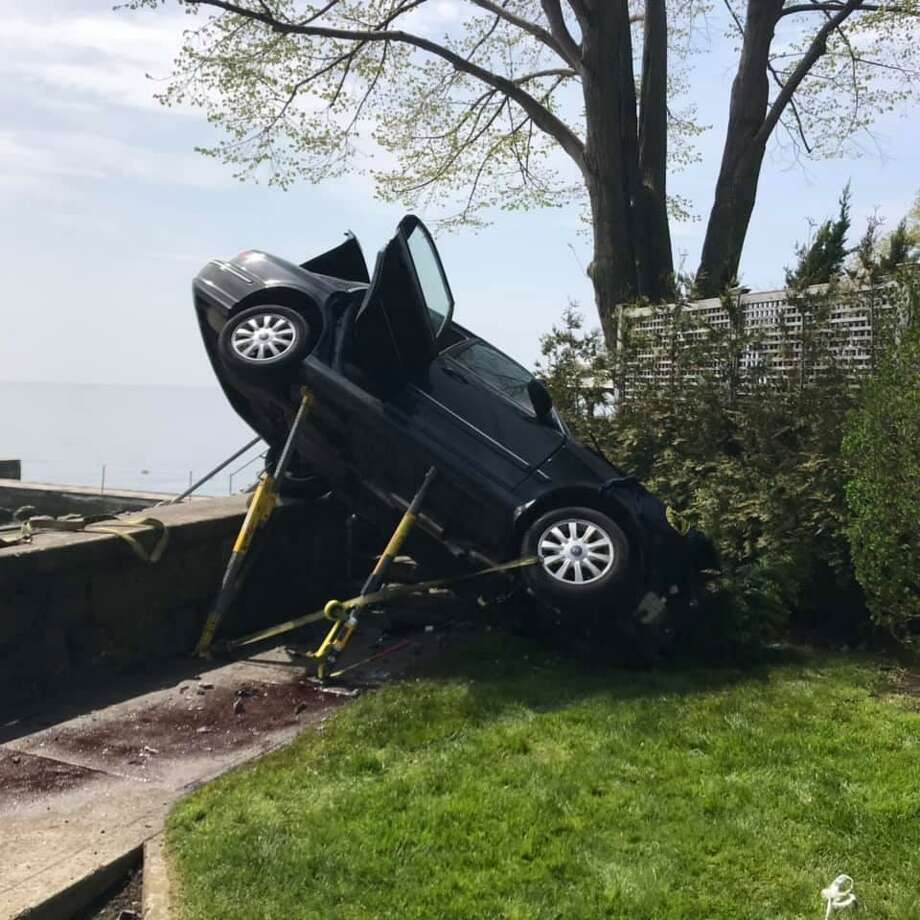 A 71-year-old Stamford man died after crashing his 2004 Hundai four-door into the seawall at the end of Shippan Point late Thursday morning. Photo: Stamford Fire Department / Contributed
