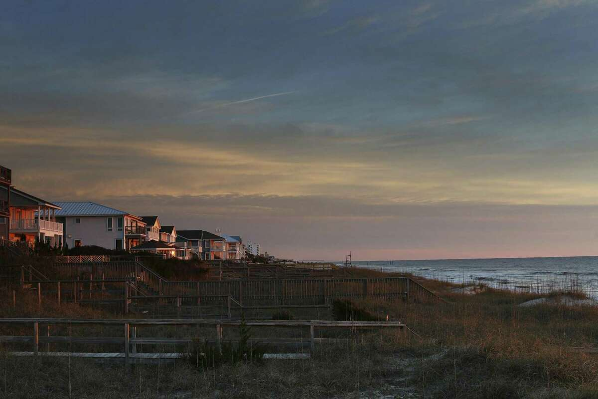 Coastal homes at sunrise in Kure Beach, N.C. President Donald Trump's plans to open the Atlantic Ocean to offshore drilling have run into political and legal roadblocks