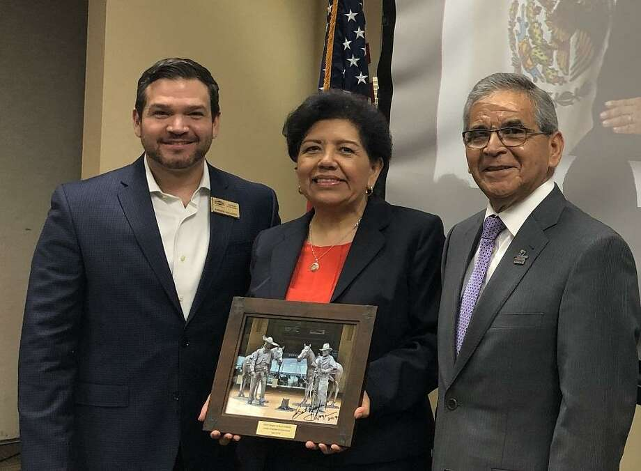 Consul General of Mexico Carolina Zaragoza, center, poses with Enrique Gallegos, left, chairman of the Laredo Chamber of Commerce board of directors and Miguel Conchas, president and CEO of the chamber. Photo: City Of Laredo