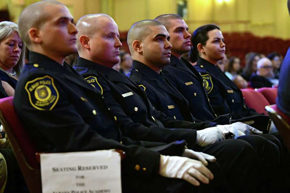 Graduates listen to Albany Police Chief Eric Hawkins deliver the chief address as 15 of Albany?•s newest police officers graduate from the 3rd session of the Albany Police Academy at the Palace Theatre on Friday, May 3, 2019 in Albany, N.Y. (Lori Van Buren/Times Union)