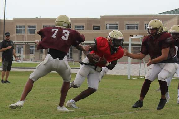 Summer Creek quarterback Bryan Bush splits defenders on the way to score a touchdown.