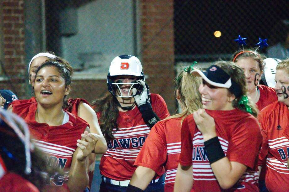 Dawson celebrates after Dawson's Courtney Day (17) hits a home run to seal the win over Summer Creek Thursday, May 2 at Dawson High School. Photo: Kirk Sides/Staff Photographer
