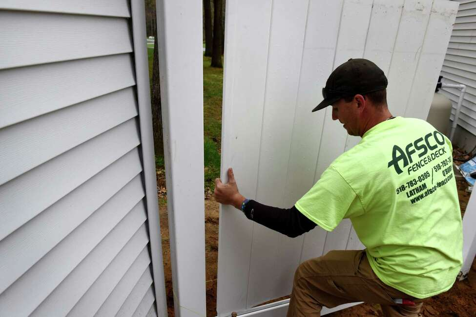 James Huntley with AFSCO Fence & Deck, installs a vinyl fence on Tuesday, April 30, 2019, in Wilton, N.Y. (Will Waldron/Times Union)