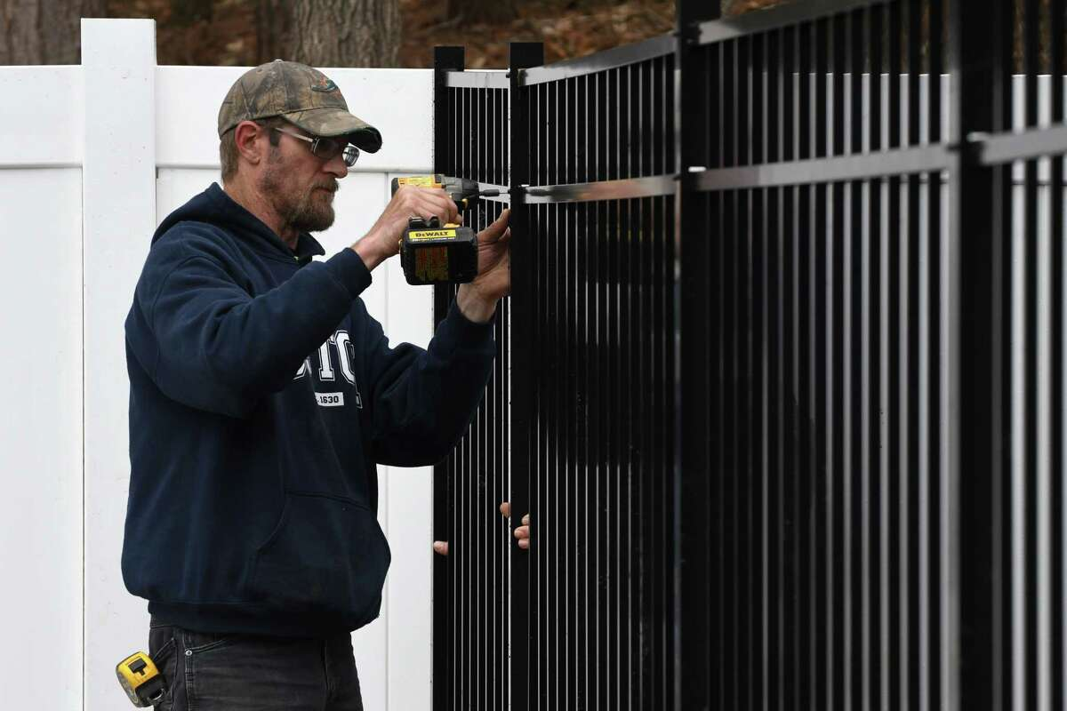 Matt Gonyea with AFSCO Fence & Deck, installs an aluminum fence on Tuesday, April 30, 2019, in Wilton, N.Y. (Will Waldron/Times Union)