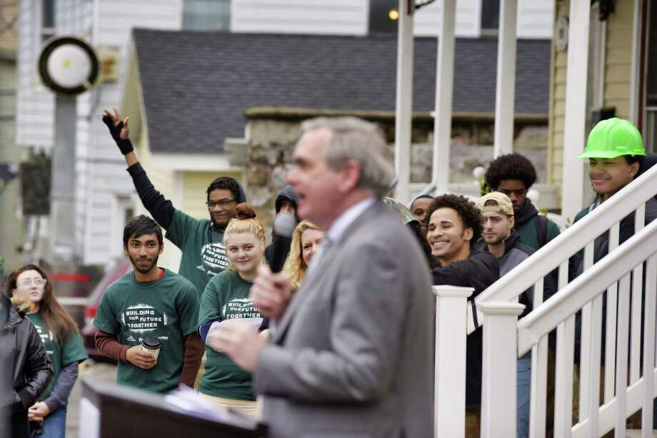 YouthBuild Schenectady students who built a net-zero home take part in an event outside the home on Wednesday, May 1, 2019, in Schenectady, N.Y.   (Paul Buckowski/Times Union) Photo: Paul Buckowski / (Paul Buckowski/Times Union)