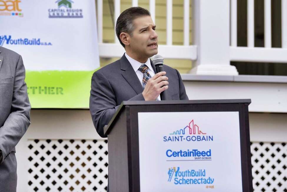 John Valverde, CEO of Youth Build USA, addresses those gathered outside of a new net-zero home at 101 Prospect Street, that was built by YouthBuild Schenectady students in partnership with Saint-Gobain on Wednesday, May 1, 2019, in Schenectady, N.Y. (Paul Buckowski/Times Union)
