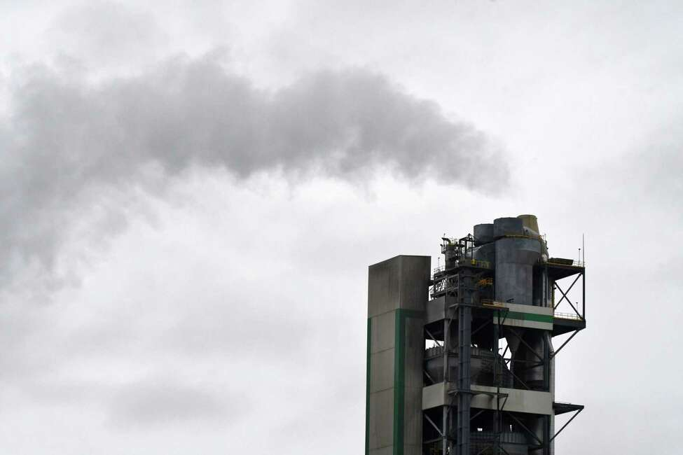 Emissions rise from the Lafarge cement plant on Friday, May 3, 2019, in Ravena , N.Y. (Will Waldron/Times Union)