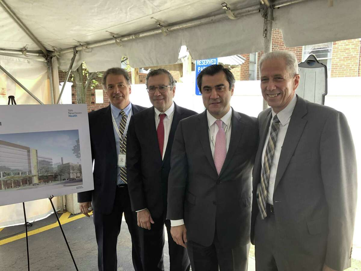 From left, Richard D'Aquila, president of Yale New Haven Health and Yale New Haven Hospital; Dr. David Hafler, chief of neurology at the hospital; Dr. Murat Gunel, chief of neurosurgery; and Dr. Robert Alpern, dean of the Yale School of Medicine; at a press conference announcing a new Neurosciences Center at the St. Raphael campus of Yale New Haven Hospital on April 29, 2019.