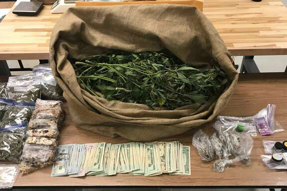 Officials with the Fort Bend County Narcotics Task Force found 10.3 pounds of marijuana, several mature marijuana plants, 48 grams of Psilocybin (mushrooms), four pounds of homemade THC infused edible, 165 grams of THC oil and over $5,000 at the home.