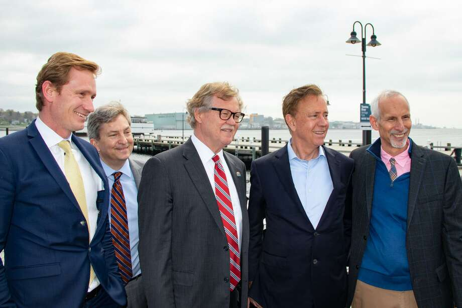 From left, Ørsted CEO Thomas Brostrøm, Connecticut Post Authority chairman Scott Bates, state Sen. Paul Formica, Gov. Ned Lamont and state Sen. Norm Needleman met in New London for the announcement of a $93 million state pier revitalization project. Photo: Contributed Photo
