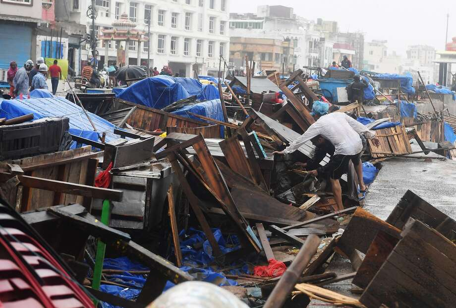 Residents inspect damage to street stalls were splintered by Cyclone Fani in the eastern India city of Puri. Photo: Dibyangshu Sarkar / AFP / Getty Images