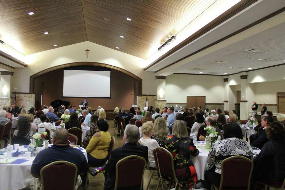 Frank Agelle, board member of Cypress Assistance Ministries, a local nonprofit helping at-risk families and people in need, speaks to the crowd at the annual Angel Breakfast on April 30, 2019. Photo: Chevall Pryce
