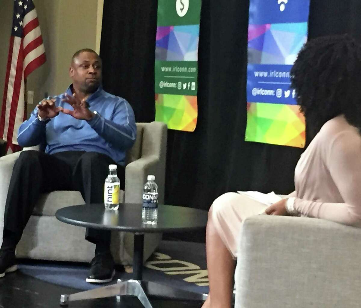 Former NFL defensive back and current NFL executive vice president of player operations Troy Vincent makes a point during an interview with entrepreneur and communications strategist Kandia Johnson during the IRLConn business conference on Friday, May 3, 2019, at 1 University Place, in downtown Stamford, Conn.