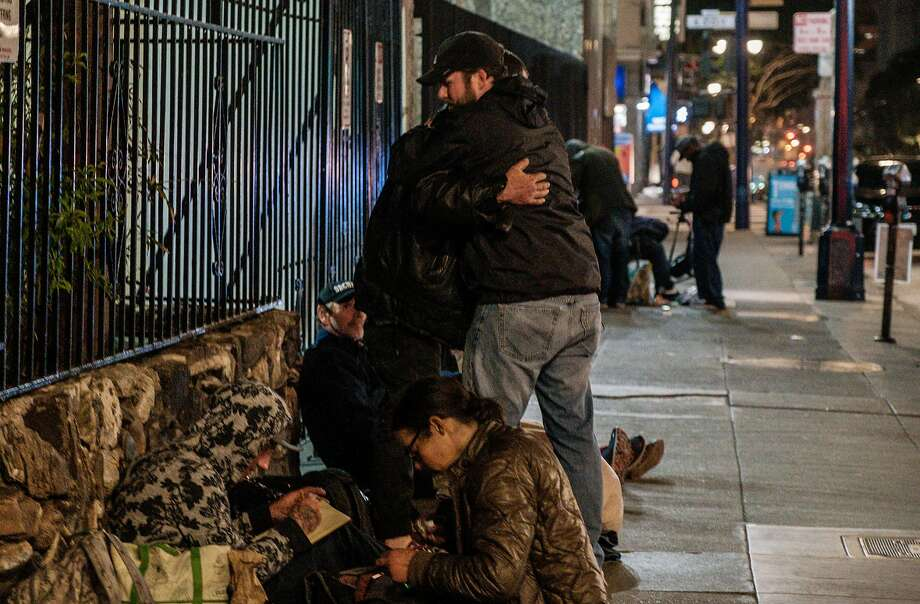 April 26, 2019 -Baron Feilzer greets his brother  Tyson for the first time in 7 years after he  and Vicki Lucas, an interventionist,  had searched the streets all day for Tyson before finding him with the help of other homeless people. Tyson was quoted, with photo, in a story earlier this month -- and Baron has flown out from Ohio to find him. He had lost track and want to save him through rehab. (Nick Otto Special to the Chronicle) Photo: Nick Otto, Special To The Chronicle