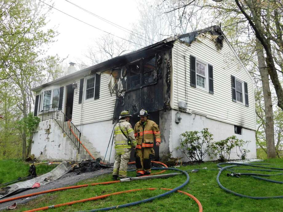 Firefighters responded to a garage fire at 12 Lakeside Drive Ext. in Ridgefield on May 3, 2019. Photo: Kendra Baker / Hearst Connecticut Media