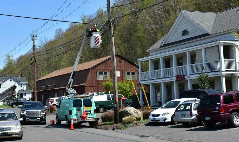 An Altice line worker at work on Thursday, May 2, 2019, in the Georgetown section of Redding, Conn. Photo: Alexander Soule / Hearst Connecticut Media.