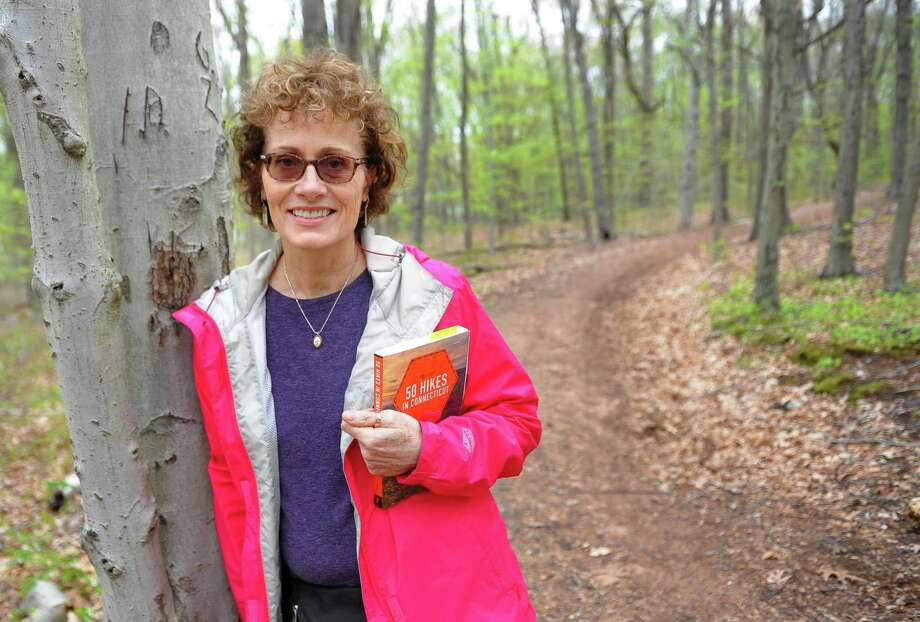 "Author Mary Anne Hardy on the red trail at Peter's Rock Park in North Haven. Hardy has written the book ""50 Hikes in Connecticut."" Photo: Christian Abraham / Hearst Connecticut Media / Connecticut Post"