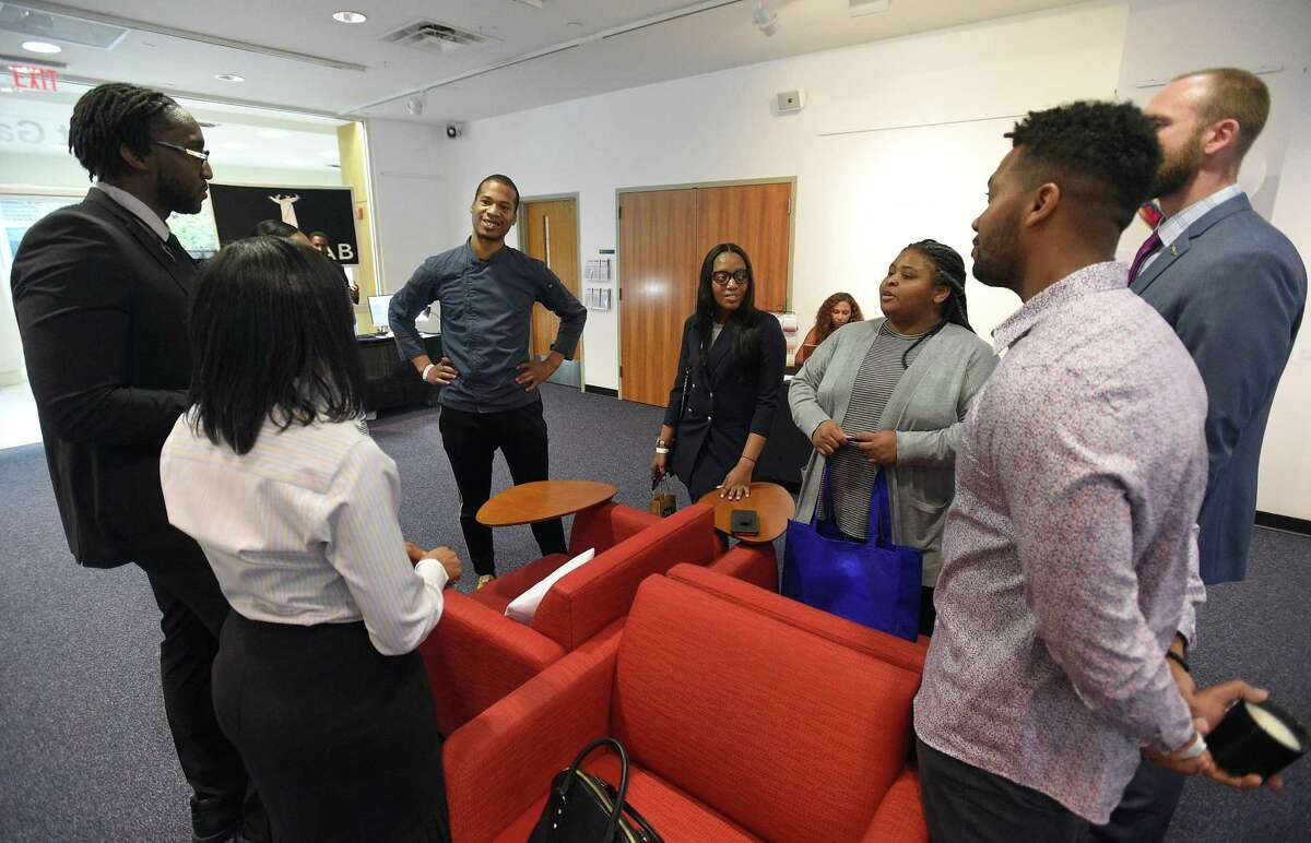 Chef Adrain Harrow, center, a Brooklyn, N.Y-based entrepreneur, speaks with attendees at the IRLConn business conference at the UConn Stamford campus, at 1 University Place, on Friday, May 3, 2019.