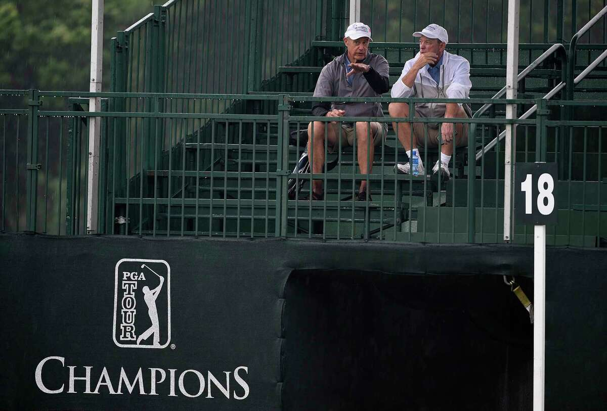 Spectators sit in the bleachers on the #18 green during a weather delay during the first round of the Insperity Invitational golf tournament, Friday, May 3, 2019, in The Woodlands, TX.