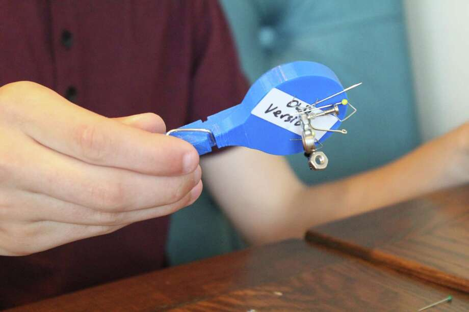 MagnaFingers can can be used to pick up small, metal objects in large groups before releasing them by pressing down on the lever. The invention was created by 16-year-old Owen Cowan. Photo: Chevall Pryce