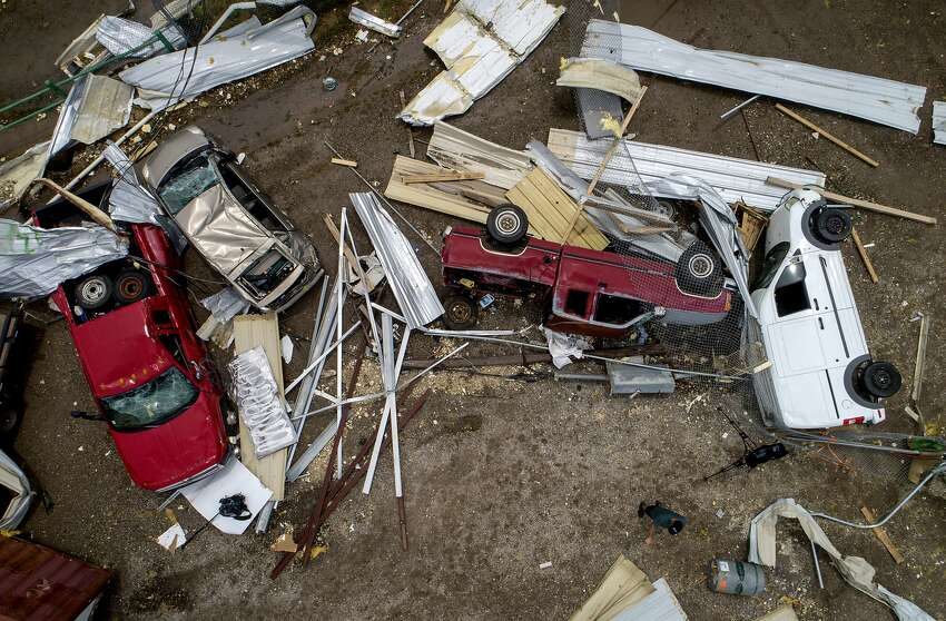 Vehicles are tossed around at McCourt & Sons Equipment Inc. after a tornado tore through the area in La Grange, Texas, on Friday May 3, 2019. (Jay Janner/Austin American-Statesman via AP)