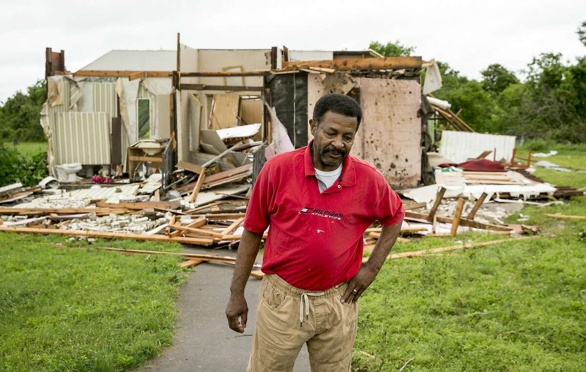 Lilton Corner walks away after viewing the damage to Mt. Zion Baptist Church, a historic African American church where he once served as pastor, after a tornado in La Grange, Texas, on Friday May 3, 2019. (Jay Janner/Austin American-Statesman via AP)