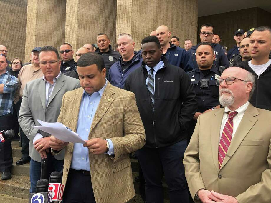 Elm City Local union President Florencio Jr., front left, and attorney Stephen McEneney, right, held a press conference on May 3, 2019, with police union members at New Haven police headquarters, 1 Union Ave. Photo: Ed Stannard / Hearst Connecticut Media