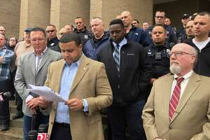 Elm City Local union President Florencio Jr., front left, and attorney Stephen McEneney, right, held a press conference on May 3, 2019, with police union members at New Haven police headquarters, 1 Union Ave.