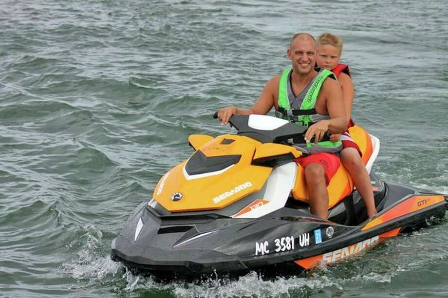 Darrin Siemen and his son, Riley, enjoy one of the jet skis that will be used at HB Jet Ski, a new jet ski rental business in Harbor Beach. HB Jet Ski will begin rentals on June 15 and will be located next to the pier in Harbor Beach. (Courtesy photo)