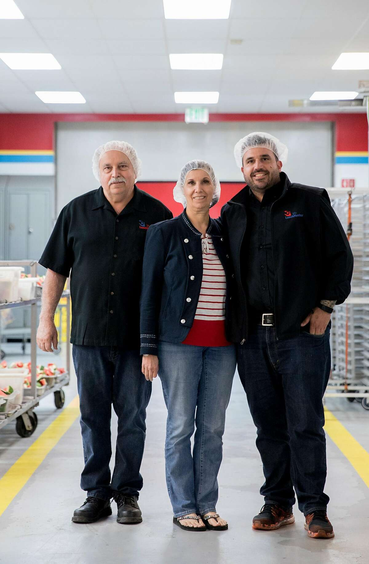 (From left) Lunch Master owners Ted Giouzelis, Marie Giouzelis and Michael Giouzelis pose for a portrait inside the Lunch Master facility in San Carlos, Calif., Friday, May 3, 2019.