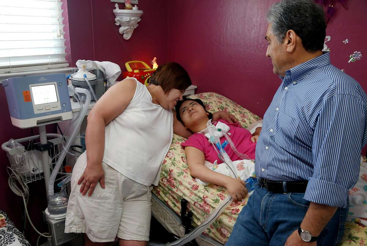 Eddie and Xiomara Lopez talk to their daughter Massiel, 24, at their home in Concord, Calif. on Friday, May 3, 2019. The family is concerned for Massiel, who has cerebral palsy and needs to be connected to a ventilator and other critical health care equipment, in the event PG&E intentionally disables power in critical wildfire conditions.