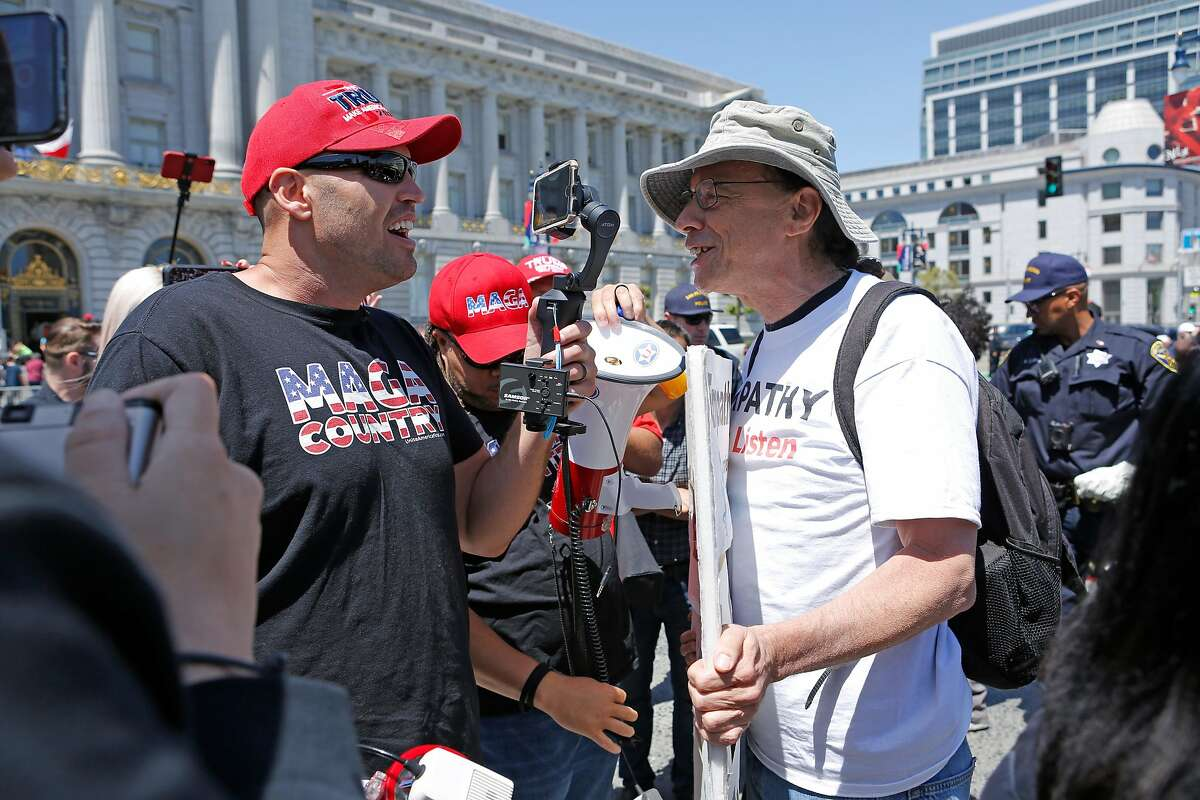 Protesters debate each other outside City Hall on Friday, May 3, 2019, in San Francisco, Calif. A group of conservatives claimed social media companies are censoring their ideologies. A second group present protested their rally.