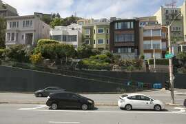 Second from left is the white painted home of Wendy Thieler-Antipa and her husband Greg Antipa who has their  Market St. home up for sale on Tuesday, April 30, 2019, in San Francisco, Calif.  Off street parking is not available in front of their home and garbage and recycling has to be brought to the bottom of the hill on lower right during pickup days.