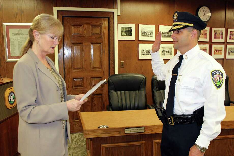 Mayor Nancy R. Rossi swears in new University of New Haven Police Chief James T. Gilman. Photo: Michael P. Walsh)